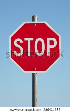 Stop sign and blue sky.