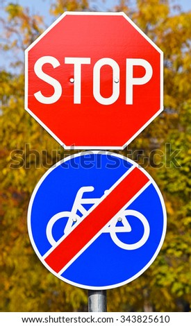 Stop sign and end of the bicycle road sign
