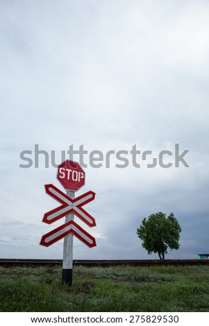 Stop sign at a railway crossing