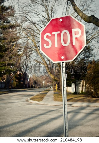 Stop sign at suburban intersection - stock photo