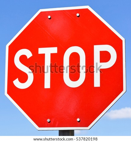 Stop sign at the road crossing