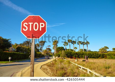 Stop sign by the empty road in Malibu California
