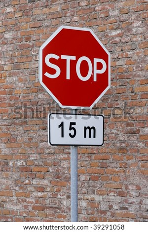 Stop sign cautioning drivers to stop in 15 meters - stock photo