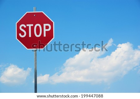 Stop sign for traffic against blue sky  - stock photo