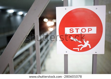 STOP sign in Sofia's subway warns passengers for fallin and high voltage danger. - stock photo