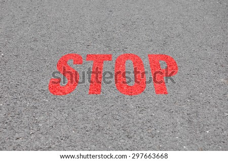Stop sign on a road - stock photo
