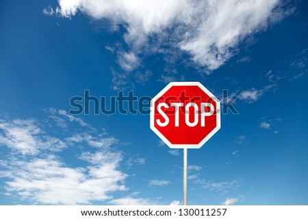 Stop sign on the blue sky