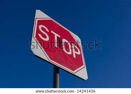 Stop sign on the blue sky background - stock photo