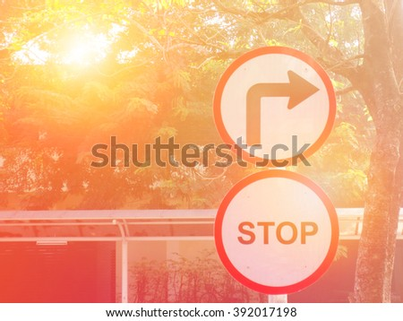 Stop sign on Wayside with sunset