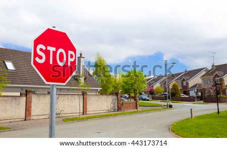 Stop sign situated in a housing area or estate to indicate cars to stop at the intersection - stock photo