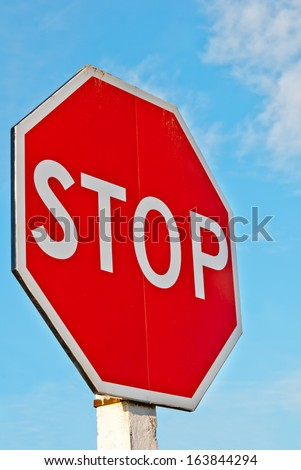 stop sign with a cloudy sky  - stock photo