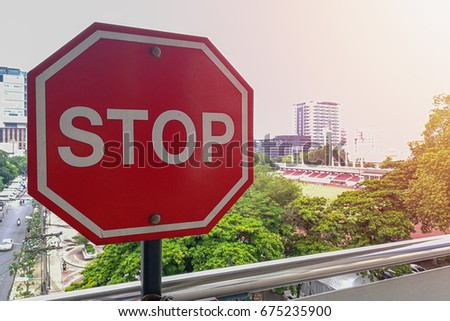 Stop sign with a street in the background