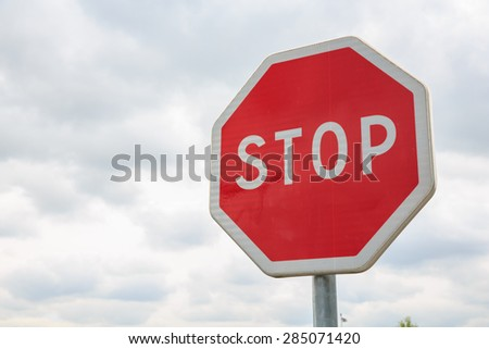stop sign with blue sky blank for text - stock photo