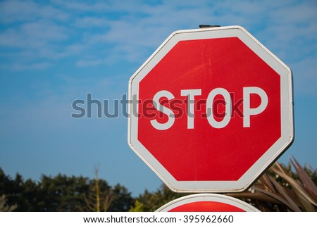 Stop sign with blue sky on the campaign