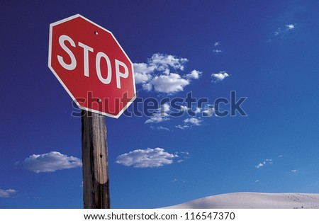 Stop signal in a desert against blue sky