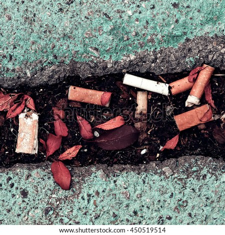 Stop Smoking. Cigarette butts on the streets - stock photo