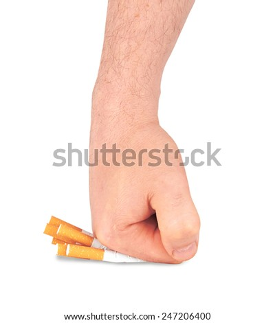 stop smoking fist with crushed cigarettes on white - stock photo