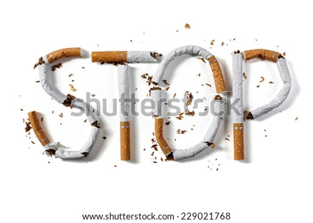 Stop smoking word written with broken cigarette concept for quitting smoking - stock photo