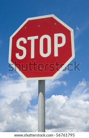 Stop street sign with blue skies and clouds in the background