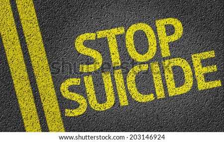 Stop Suicide written on the road - stock photo