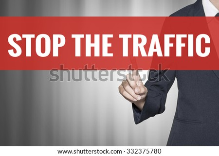 Stop the Traffic word on virtual screen push by business woman red tab - stock photo