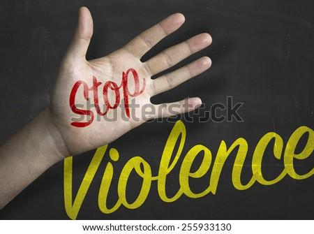 Stop Violence educacional message on blackboard  - stock photo