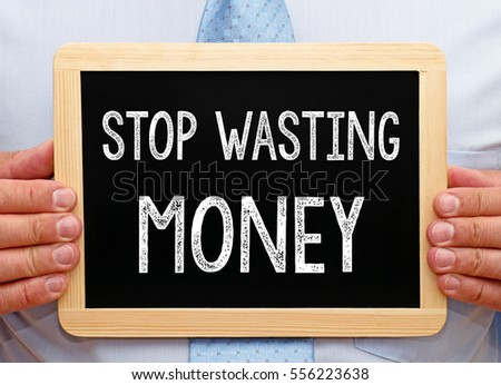 Stop wasting Money - Businessman holding chalkboard with text