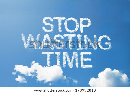 stop wasting time cloud word on sky - stock photo