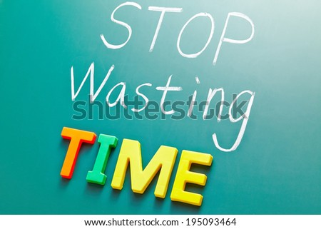 Stop wasting time concept, colorful words on blackboard - stock photo