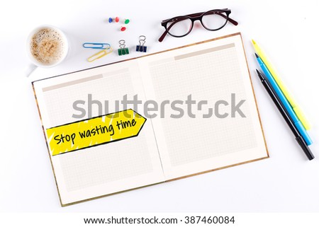 Stop Wasting Time text on notebook with copy space - stock photo