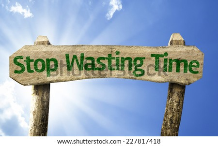 Stop Wasting Time wooden sign on a beautiful day - stock photo