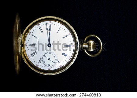 Stop watch with black background - stock photo