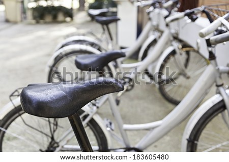 Stops in the city Bicycles, detail of a means of transportation on the street, health and environment - stock photo
