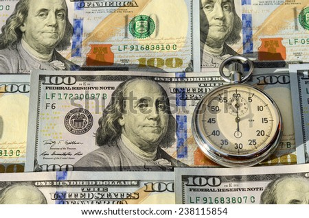 Stopwatch and dollars (time is money, capital, savings, profit - concept) - stock photo