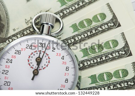 Stopwatch and dollars. Time is money concept