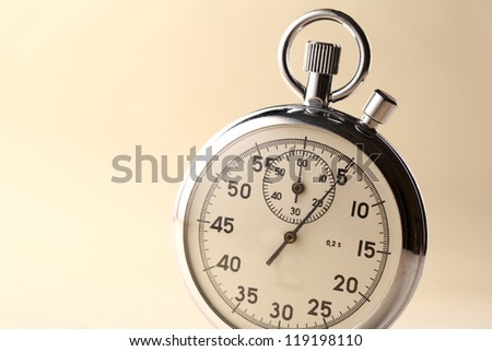 Stopwatch closeup on beige background