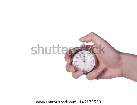 Stopwatch in a female hand on a white - stock photo
