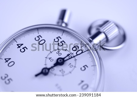 Stopwatch in blue toning - stock photo