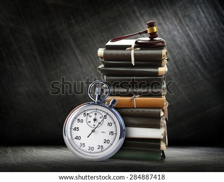 Stopwatch on steel scratchy background and folders - stock photo