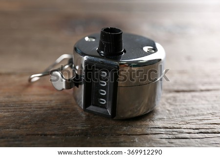 Stopwatch on wooden background, close up - stock photo