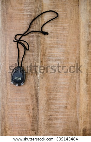 Stopwatch with copy space on wooden table