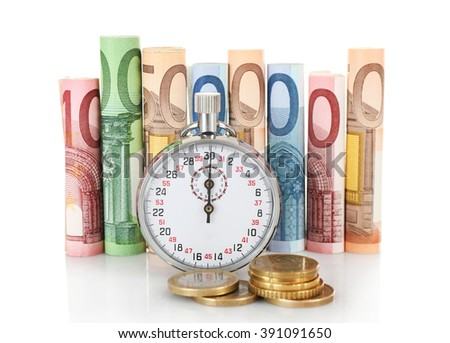 Stopwatch with twisted euro banknotes and coins, isolated on white. Time is money concept - stock photo