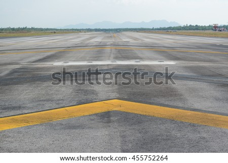 Stopway of a runway with yellow chevron marking - stock photo