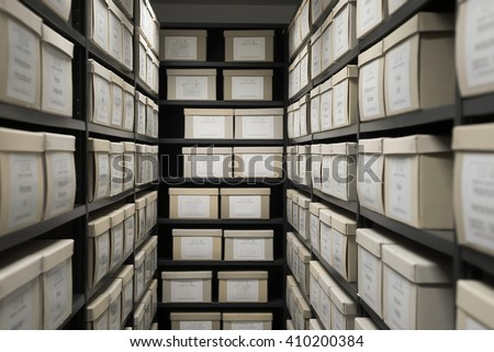Storage archive depository black shelves with white office boxes card file lab cabinet evidence. - stock photo