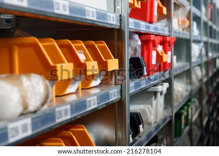 Storage bins and racks in a warehouse shot with selective focus - stock photo