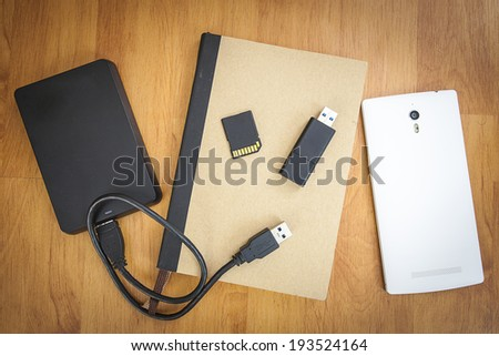 Storage device such as SD card, usb flash drive, external hard drive, Mobile phone and note book - stock photo