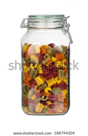 Storage jar with colorful Pasta Noodles isolated on white Background