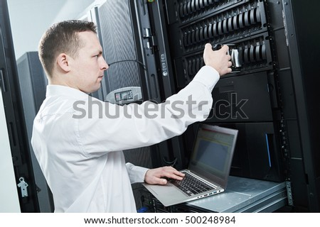 Storage maintenance. Service engineer in server room