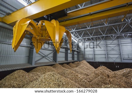 storage of wood chips - stock photo