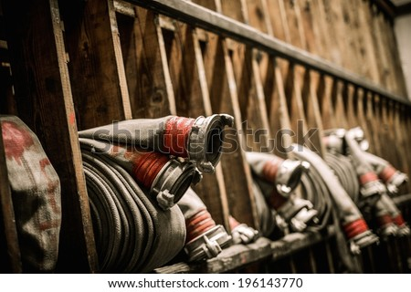 Storage room in firefighting depot with water hoses  - stock photo